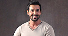 John Abraham loves to keep calm, stay low...and deliver